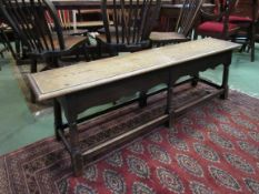 A Victorian oak joined long stool/bench with wavy frieze,