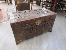 An early to mid 20th Century heavily carved Oriental camphor wood chest,
