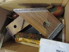 A box of musical instruments and accessories including Zippy Zither