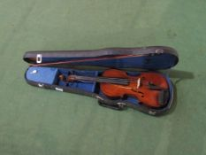 A late 19th/early 20th Century full size (4/4) violin, two piece figured maple back, student's bow,