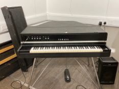 A Yamaha CP70b electric grand piano with foot pedal and separate PA amplifier