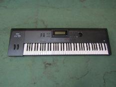 A Yamaha W5 keyboard synthesizer