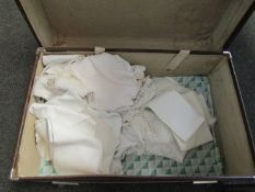 A suitcase with linen contents