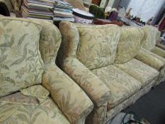 A Multiyork three piece suite (two seater and pair of chairs) with loose covers