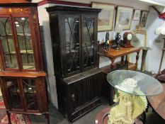 A heavily carved oak bookcase with astragal glazed doors,