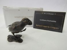 A limited edition solid bronze marauding puffin, boxed with certificate, 117/200, 4.