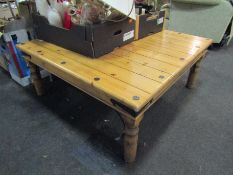 A metal studded pine square form coffee table,