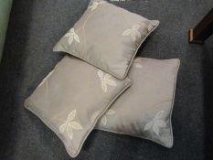 Three silk cushions with leaf detail