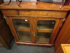 A 19th Century maple pier cabinet with gilt embellishment,