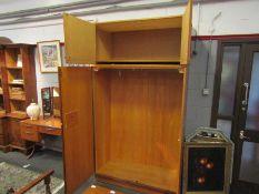A mid Century Uniflex teak wardrobe, two pairs of doors,