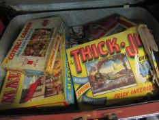 A case of vintage boxed games/jigsaws,