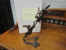 A pair of limited edition solid bronze boxing hares, boxed with certificate, 122/250,