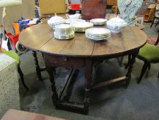 An 18th Century and later oak gate-leg table