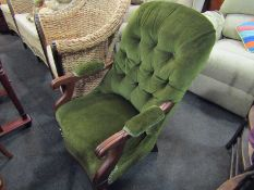 A Regency walnut button back armchair,