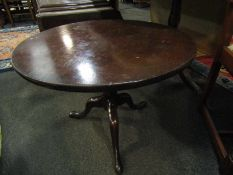 A 19th Century mahogany tilt top low wine table