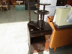 A wooden three tier plant stand and an oak bedisde cabinet