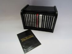 THE BEATLES: A 1988 roll top 'bread bin' containing sixteen CD albums,