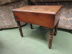 A circa 1880 mahogany commode with ceramic liner on turned legs,
