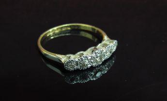 An 18ct gold platinum set five stone illusion set diamond ring. Size Q, 2.