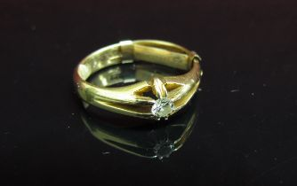 An 18ct gold gent's ring set with single diamond in open mount. Size R, 5.