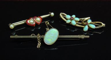Three gold bar brooches, red enamel heart and pearl, opal and ruby flowers and oval opal examples,