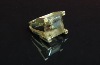 A square cut smoky quartz ring set in high four claw mount and split shank stamped 14k. Size J, 12.