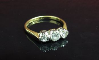 A gold three stone diamond ring, central stone .25ct flanked by .