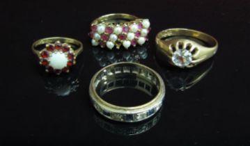 Three 9ct gold dress rings and an eternity ring (4) 13.