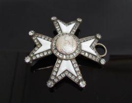A Maltese Cross brooch/pendant set with semi-precious clear stones