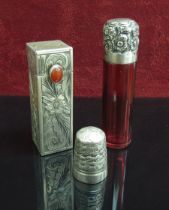 A silver topped ruby glass scent bottle,