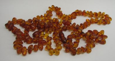 Two amber bead necklaces, 70cm and 60cm long, 73.