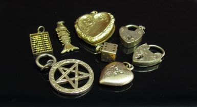 A bag of mainly gold lockets and charms including abacus, heart, 9ct gold and 14k (16.4g 9ct, 3.