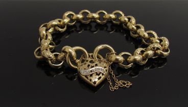 A gold engraved link bracelet with pierced heart padlock set with a row of diamonds (one missing),