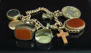 A 9ct gold bracelet hung with goldstone cross, citrine swivel fob,