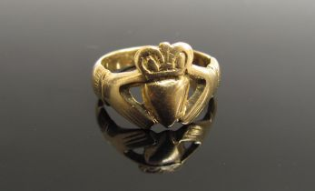A gold Frienship ring, hands holding a crowned heart, unmarked,
