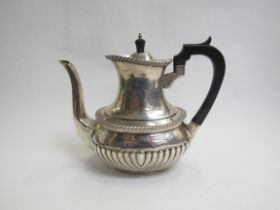 A Mappin & Webb silver coffee pot with fluted detail, ebony knop and handle, Sheffield 1915,