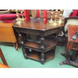 A 17th Century style oak three tier credence table the carved frieze over turned and square legs,