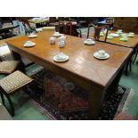 A burr walnut patch veneered dining table,