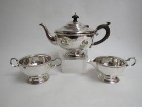 A Marson & James silver three piece tea set, beaded rims, Birmingham 1931,