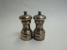 A John Bull Ltd silver pair of salt and pepper grinders,