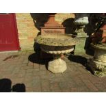 A pair of urns on socle's,