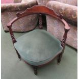 A late Victorian walnut corner chair on ring turned legs and brass castors,