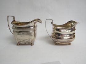 Two London Georgian silver milk jugs with ball feet. One marks are rubbed the other is T.