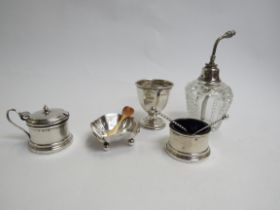 A silver egg cup, mustard, salt atomizer and another salt, various makers and dates,