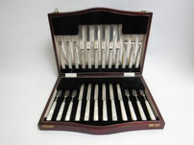 A cased set of silver Cooper Brothers & Sons Ltd mother of pearl dessert knives and forks,