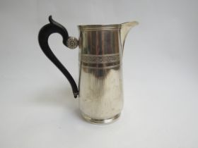A Continental silver hot water jug with ebony handle, 18cm tall,
