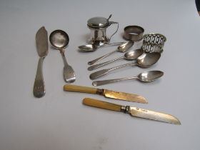 A quantity of silver items including teaspoons, sauce spoon and table salt.