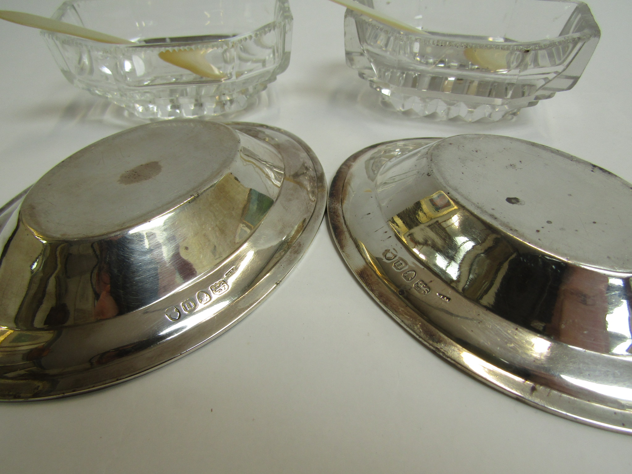 A pair of George III silver table salts, the silver bases accommodating cut glass bowls, - Image 2 of 2