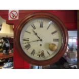 A Victorian dial clock with Roman numerated face,