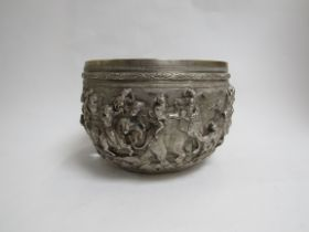 A Burmese white metal jardiniere with deep relief of military procession, elephants and horseman,
